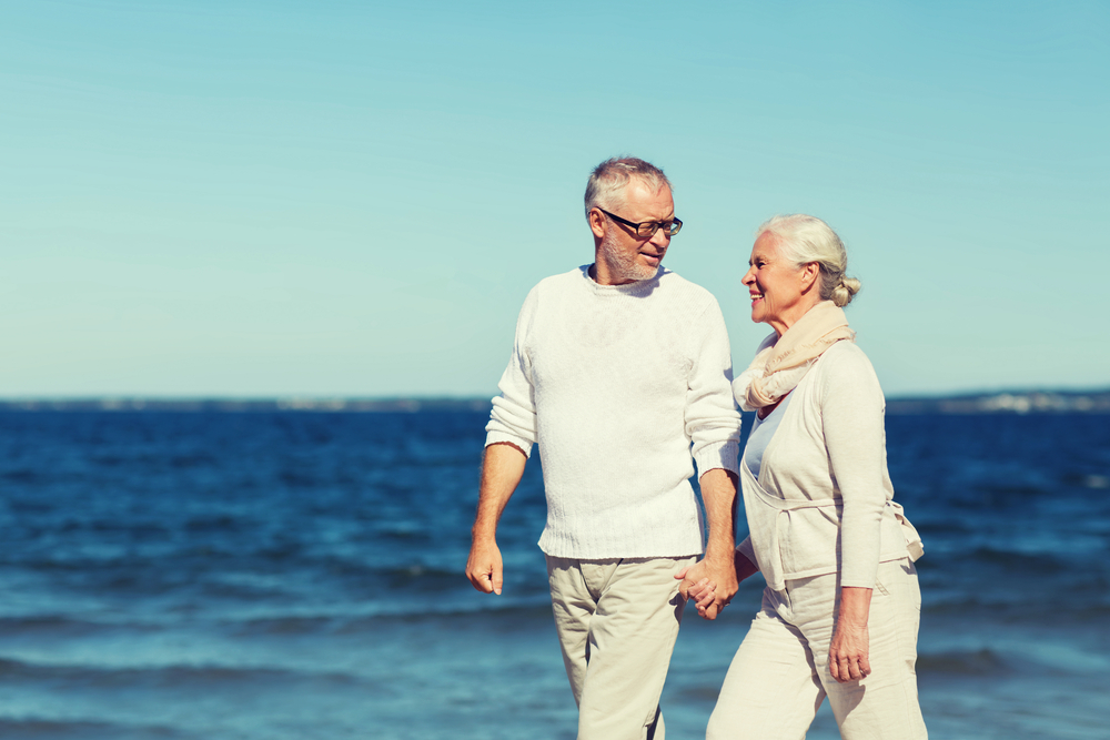 Older Couple Walking Along the Water